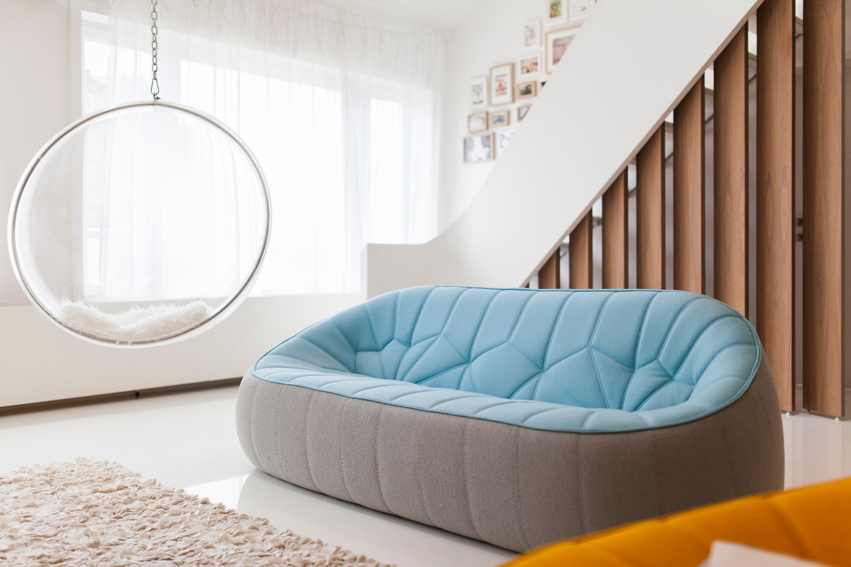 Retro Hanging Chair - Hungarian loft design uses a simple aesthetic for big stylish results