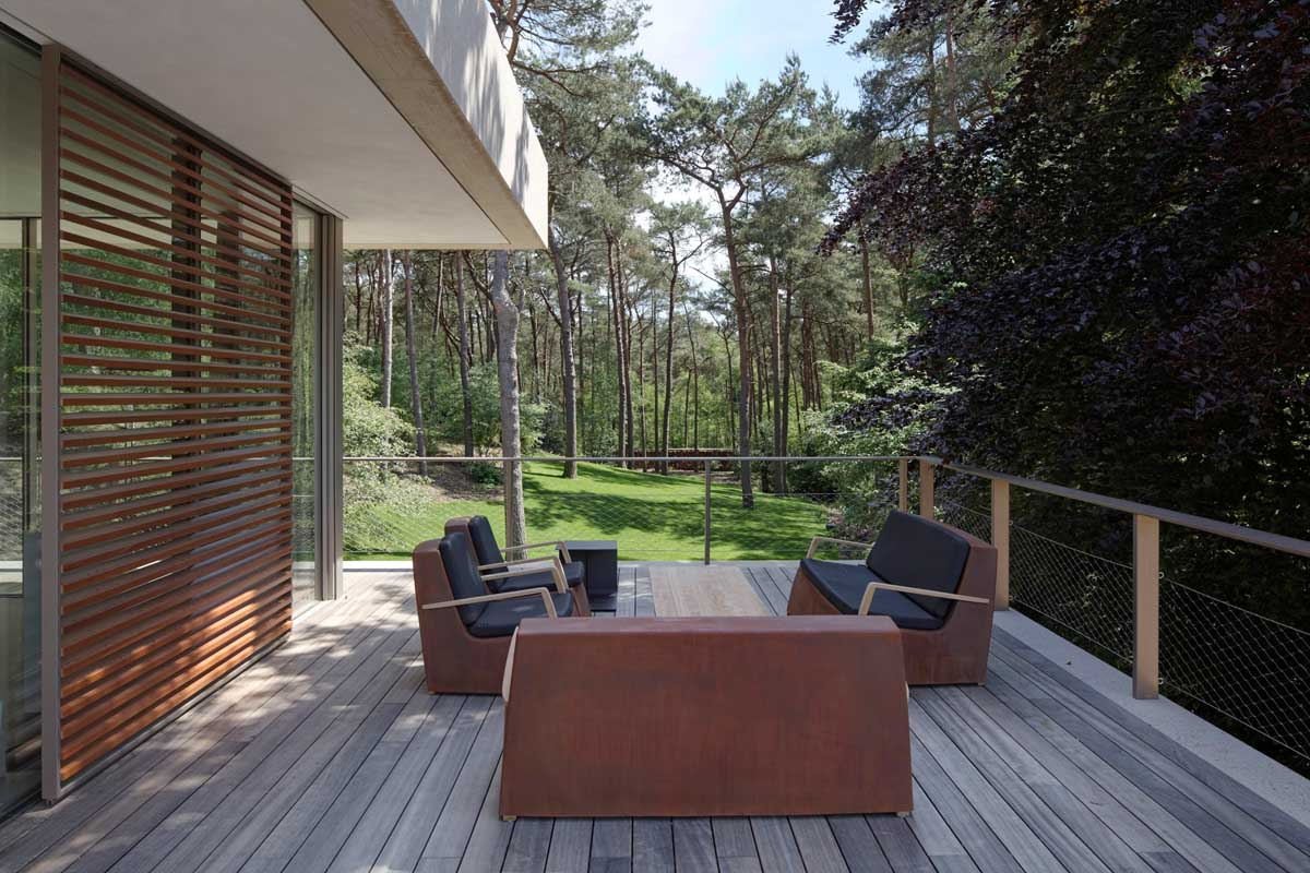 Rustic Back Deck - Modern exterior complements its gorgeous natural surroundings