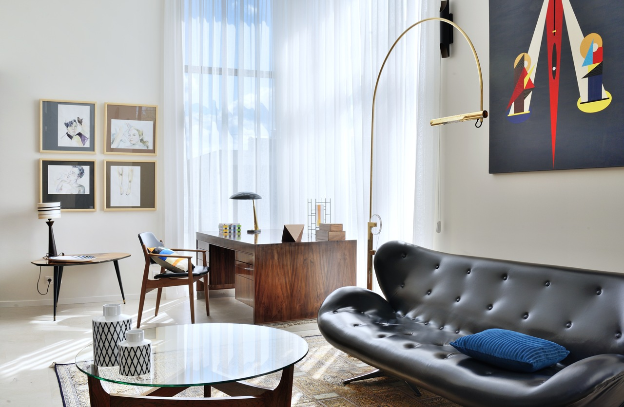 Sleek Leather Sofa - An eclectic moscow home showcases color and creative style
