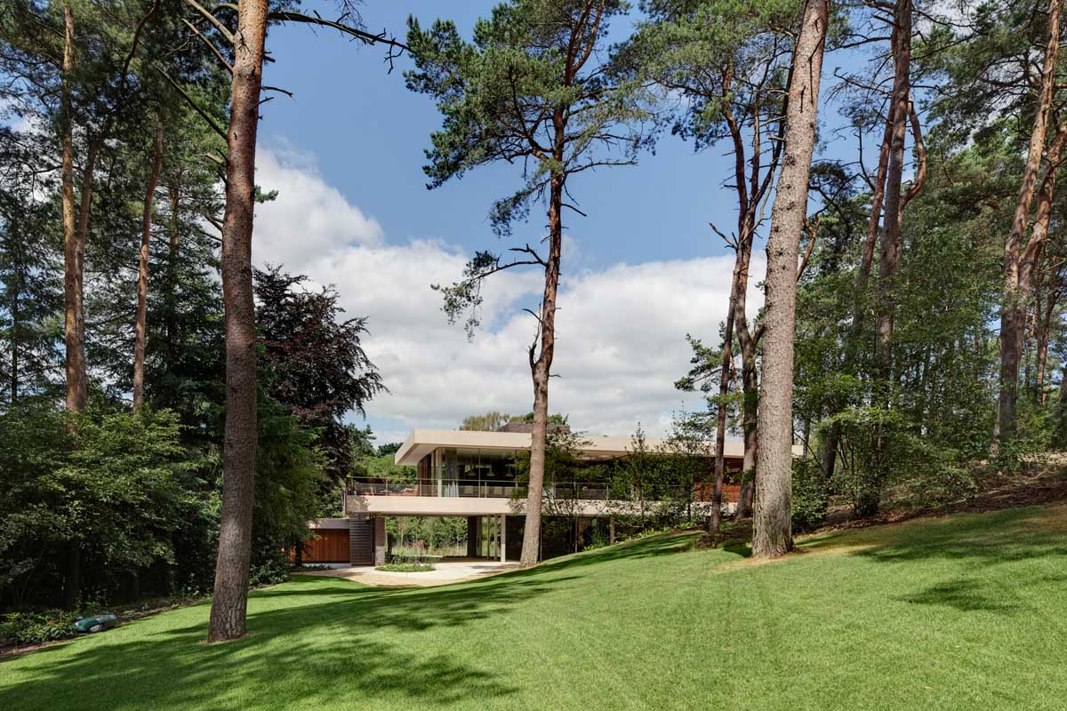 Spacious Green Yard - Modern exterior complements its gorgeous natural surroundings