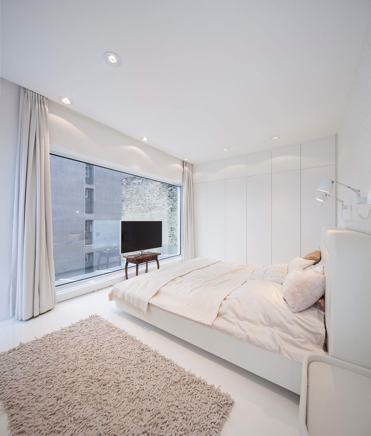 Hungarian loft design uses a simple aesthetic for big for Upstairs bedroom ideas