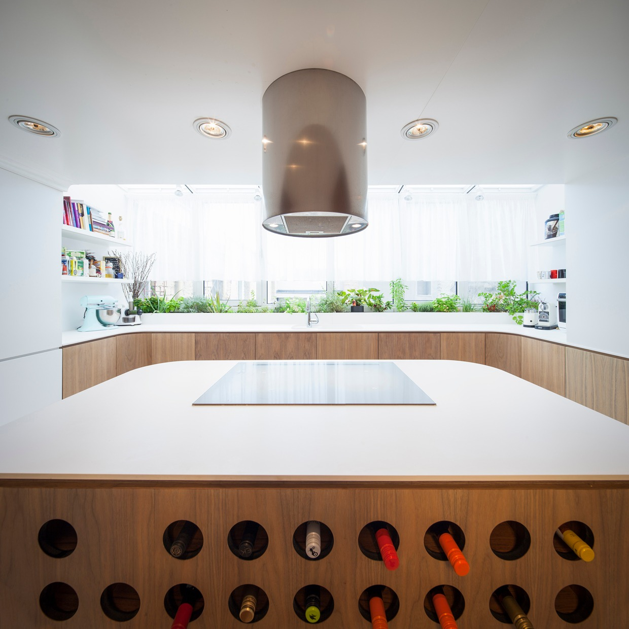 Wine Storing Kitchen Island - Hungarian loft design uses a simple aesthetic for big stylish results