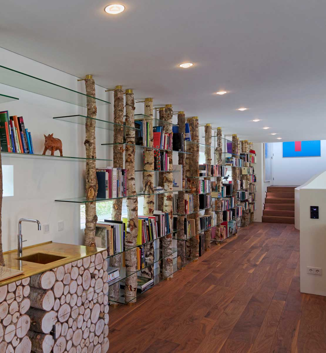 Wood And Glass Bookshelf - Modern exterior complements its gorgeous natural surroundings