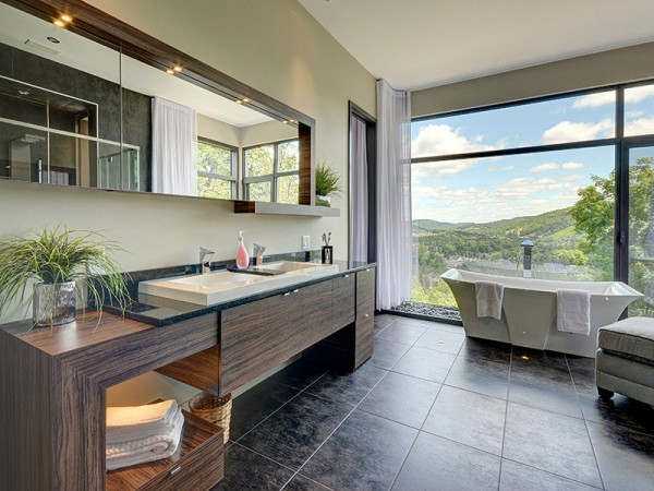 Of course, one of those baths has a porcelain soaking tub overlooking the mountain range below.