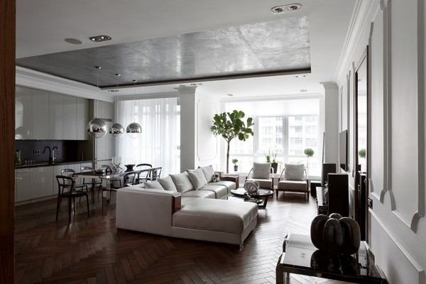 A brushed metal panel in the ceiling gives an edgy dimension of industrial style to the otherwise classic design. A buttery leather sofa in creamy white is a focal element, inviting guests to sit and relax with a glass of champagne - but never pinot noir.