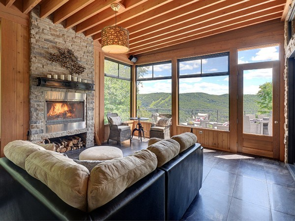 Exposed wood ceiling beams certainly give the home that cabin feel, but there are not very many cozy retreats that could boast such luxury. The home feels as if it goes on forever, though it only has three bedrooms and three baths.