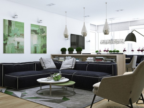 Green accents from the wall art to the area rug to various plants sprouting around the space give it a very lively feel. A deep and soft navy blue sofa brings a water element into the sunny space and makes the white walls really pop.