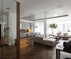 The first apartment comes from architect Sergey Makhno and uses many neutral colors to create a simple but luxurious atmosphere throughout the house. The herringbone hardwood floors serve as a foundation for a largely white and wood interior.