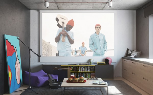 A home projection system is an ideal media solution in an artist's apartment because it allows for the consumption of even more types of whimsical art - such as The Life Aquatic with Steve Zissou as seen here - but doesn't require a television, which can detract from the overall style of a room.
