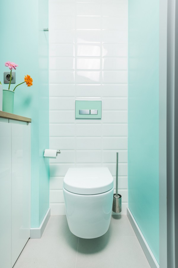 A lovely mint green bathroom is instantly inviting and vibrant, much more so than a standard neutral design.