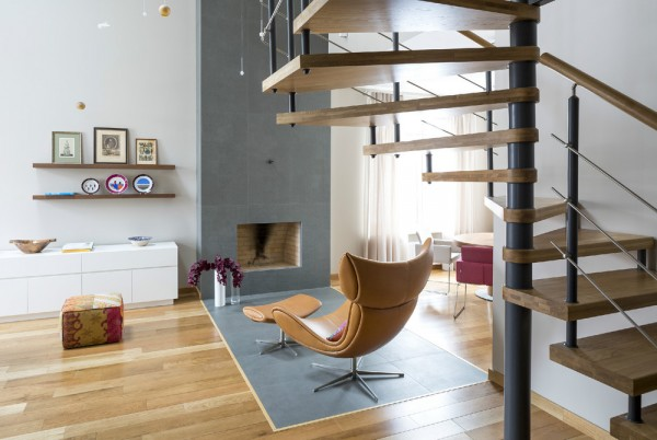 The main living area is wide open, framing a modern spiral staircase that carries you up to the second floor. Though neutral colors dominate, it is the perfect splashes of those unexpected deep burgundy or the rich and decadent caramel colored leather than bring a boisterous life into the space.