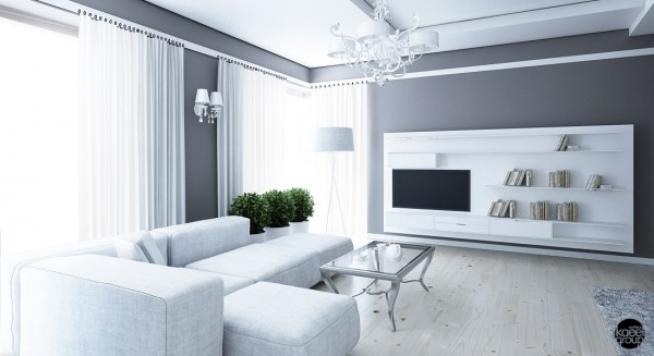The surfaces and angles of this dreamy white and silver apartment are paramount to its overall feel. Something as simple as the metallic coffee table sitting just exactly as high as the soft gray sofa creates long, languorous lines that make the entire space feel open, airy, and comfortable.