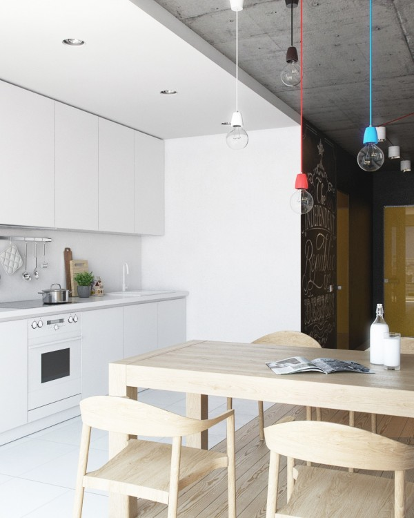 A small kitchen and dining area use bright white and light wood to create an open and welcoming feeling. Bare bulbs with cords in primary colors are a playful addition to the space.