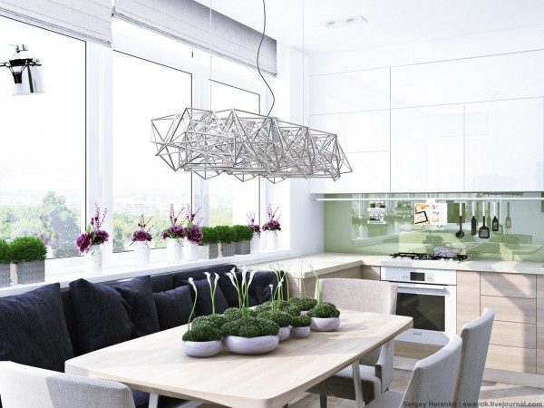 In the dining room, we can again see the impact of light fixtures against a white backdrop. Here, a truly unique sculptural piece hangs over the table in place of a more traditional chandelier. However, the plants on the table and windowsill balance the fixture so it draws the eye without taking over the room.