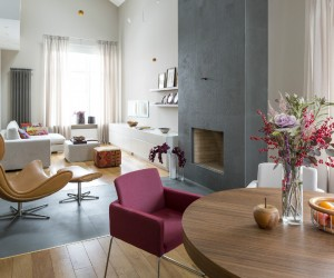 The first apartment comes to us from designer Yarovikova Anna and was designed with the needs of a modern life in mind. Bright light filters into the home from multiple windows, but it comes through simple, neutral curtains that use their vertical folds to add height to the ceiling and the room.