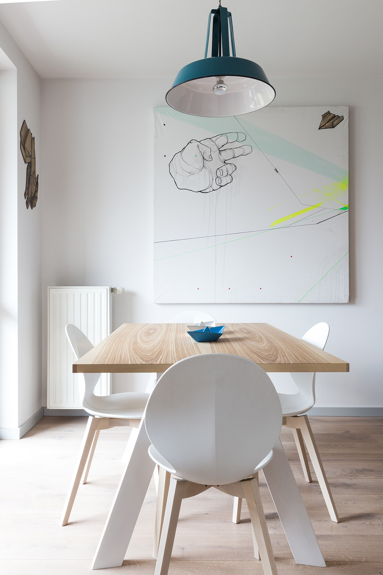White And Wood Dining Table - 2 creative apartments featuring whimsical art