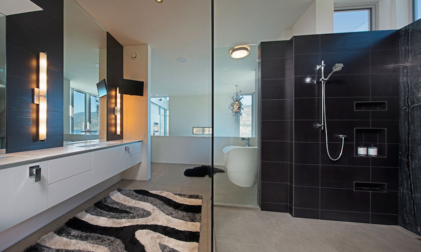 Black Tile Shower - Ultramodern lake house with luxurious details