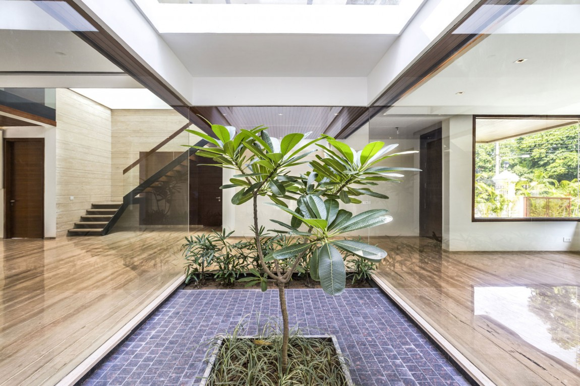 A sleek modern home with indian sensibilities and an What is an atrium in a house