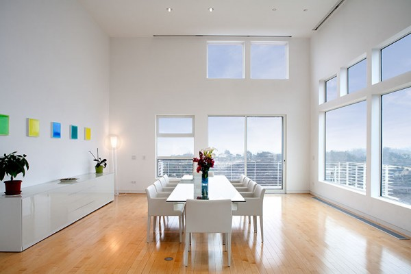 The interior of the home, which was completely redone in 2008, is bright, open, and modern. California sunlight streams in from window stacked atop window inside the three-story space. Visitors (and residents...and butlers) are carried to all private rooms in a glass elevator that opens out into a master suite, private gym, and staff quarters.