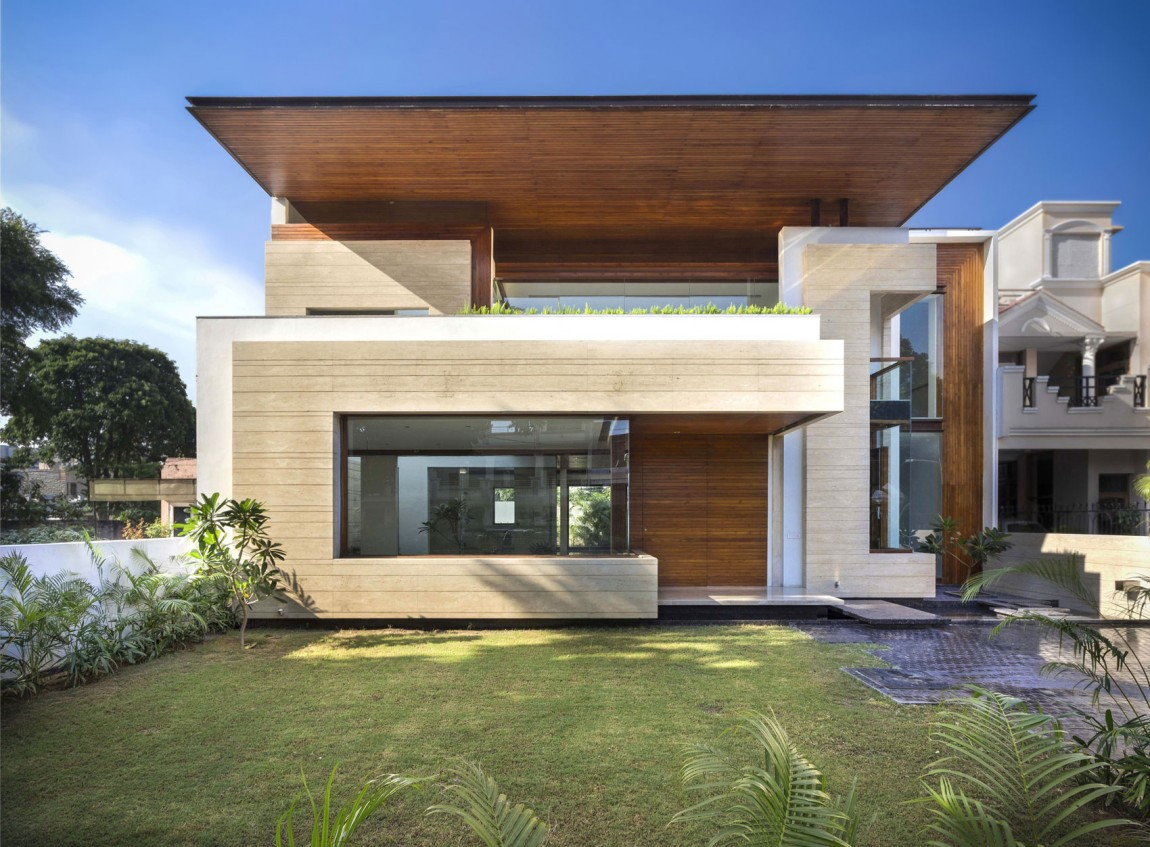 A sleek modern home with indian sensibilities and an Indian home exterior design photos