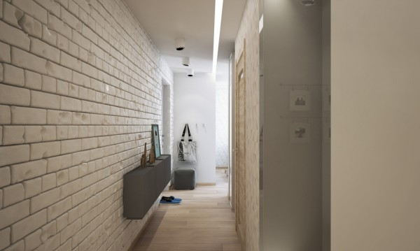 The entryway to the home is narrow, out of necessity, but there still manages to be a bit of personalization, through use of a mounted console as well as a few personal photos, artfully displayed.