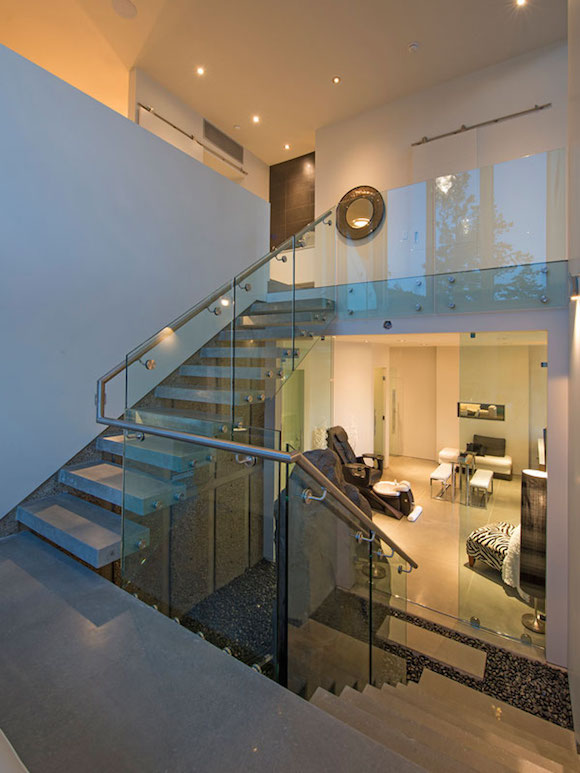 Glass Staircase Design - Ultramodern lake house with luxurious details