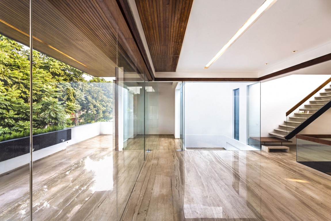 a sleek modern home with indian sensibilities and an interior courtyard - Interior Glass Walls For Homes