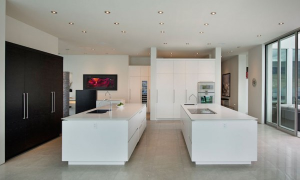 The gourmet kitchen has an enviable amount of slick white counter space, perfect for setting out a continental breakfast before spending a day on the boat.