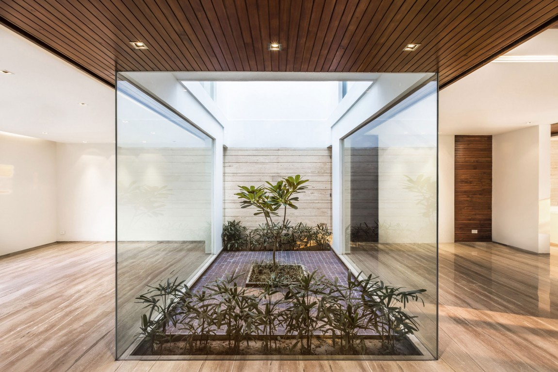 A sleek modern home with indian sensibilities and an for Home interior garden