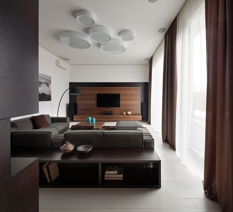 A modern summer cottage utilizes tons of gorgeous walnut for Bedroom designs with attached bathroom and dressing room
