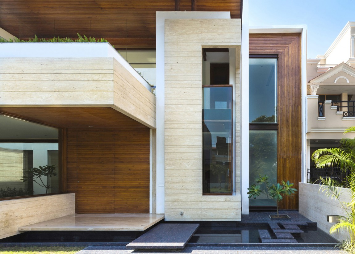 A sleek modern home with indian sensibilities and an for Wood house exterior design