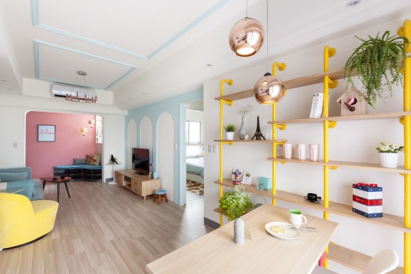"The first home from the interior designers at House Design, with photography from Hey! Cheese. It is a bright and playful design with plenty of gorgeous pastel color, inspired by those delicate, delicious cookies: the French macaron. The home, which the designers refer to as ""The Wonderland Apartment"" is 86 square meters (925 square feet) and was designed for the vibrant and positive personality of the teacher that lives there. It is clear from the pretty pinks, pale blues, and playful elements such as animal-themed pillows and asymmetrical objects, that this space is for someone who celebrates life and whatever it throws at her. Despite the fairly small size, the apartment feels incredibly open and welcoming, surely a lovely place to entertain friends or spend a cozy evening in."