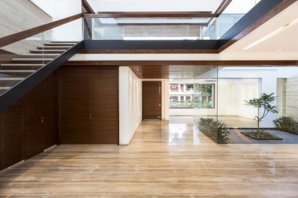 Shiny stone floors a sleek modern home with indian sensibilities and an interior