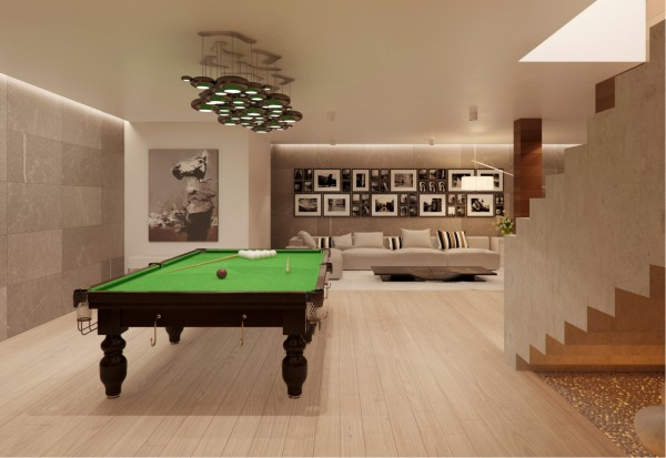 The finished basement is another opportunity for beautiful lighting with a creative, reflective cluster fixture perched over the pool table while nearly white wood flooring and an oatmeal sofa finish the look.