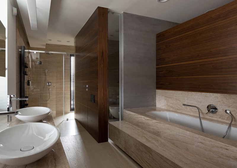 Stone And Wood Bath - A modern summer cottage utilizes tons of gorgeous walnut