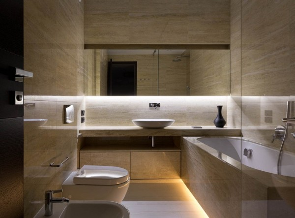 In the bathroom, beautiful stone tiles take the place of the walnut, giving it a bit more life and texture than standard marble might provide.