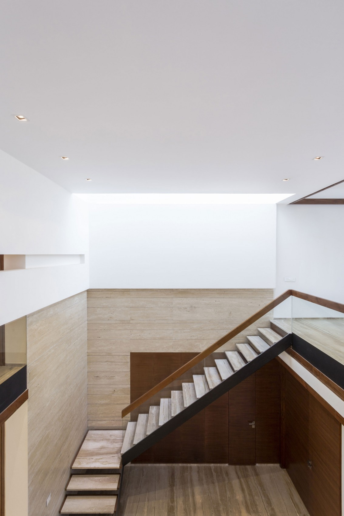 Stone Staircase - A sleek modern home with indian sensibilities and an interior courtyard