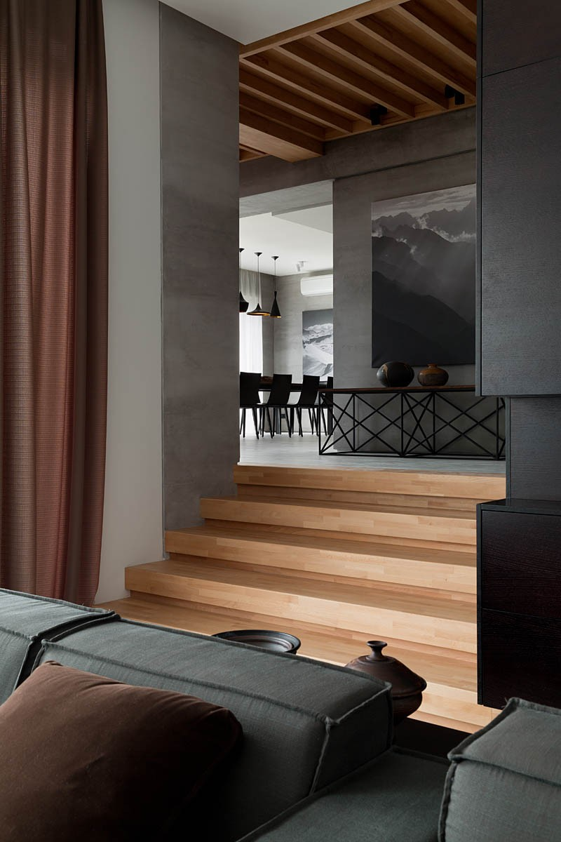 A modern summer cottage utilizes tons of gorgeous walnut for Houses with sunken living rooms