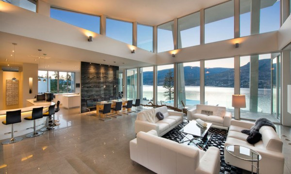 Readers of this blog will express no surprise at the main living area's open floor plan, which lends itself to amazing views of the lake and surrounding wilderness. Windows from the floor to ceiling are sure to let in the colors of every Canadian sunrise and provide a perfect backdrop for weekend entertaining.