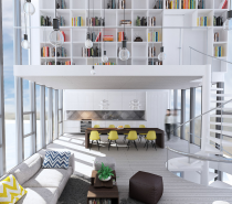 The first stunning space is a multi-level loft with sky high windows. Bare bulbs dangle from long wires, lighting up the main living room like fireflies at night while sun streams in and across the beachy inspired furnishings and chevron striped throw pillows by day. Of all the impressive features, you cannot help but be drawn to the stunning second floor library, where white shelving reaches the ceiling and is stacked high with beautiful books.