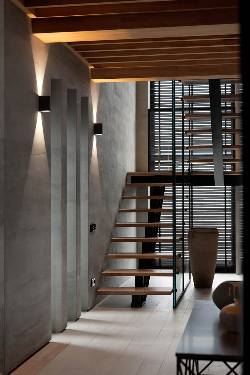 Wood Board Staircase - A modern summer cottage utilizes tons of gorgeous walnut