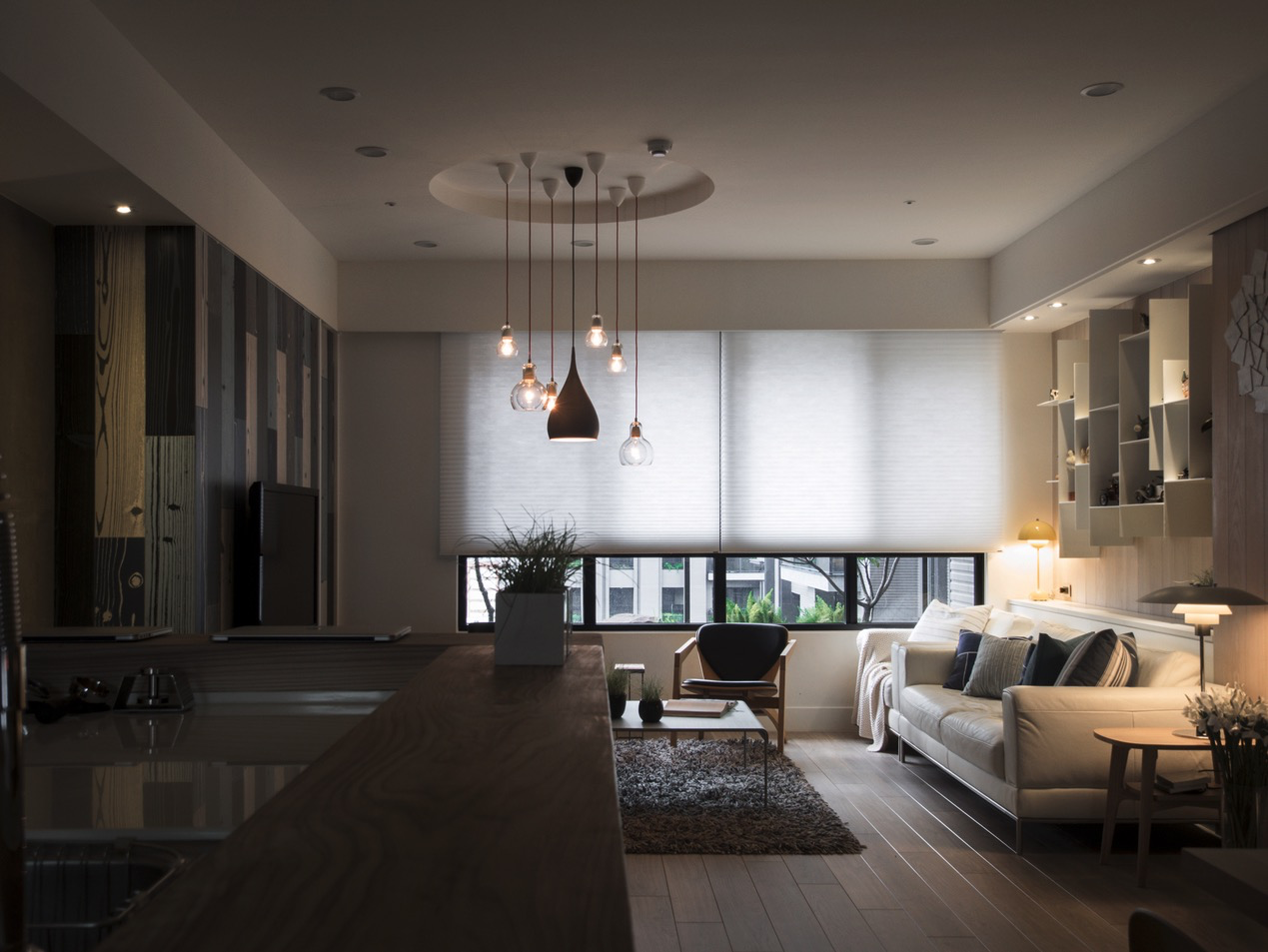 A warm wood home in taiwan with a beautiful cozy reading nook for Modern apartment living room