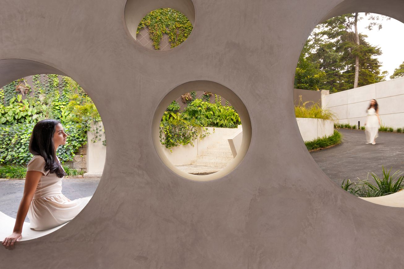 Creative Concrete Design - A warm stone exterior houses an intimate residence