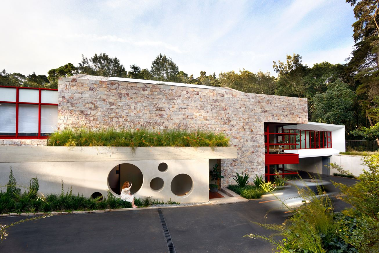 Creative Modern Exterior - A warm stone exterior houses an intimate residence