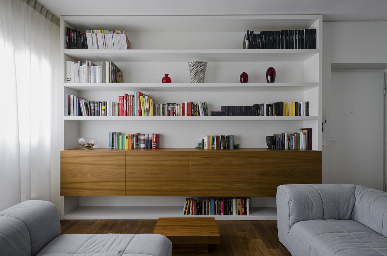 Custom Book Shelving - Italian apartment renovation brings open space to 1960s home