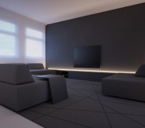The first house is located in Wroclaw and draws heavily a dark gray color palette. The main living area features a dark gray modular sofa with cushions that can easily be swapped and slid and removed according to an individual's comfort level.