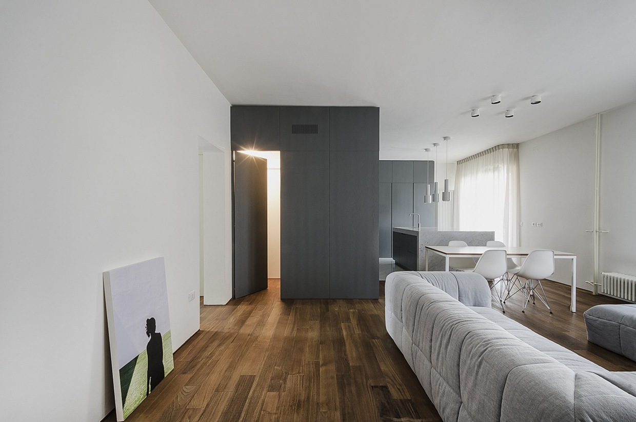 Dark Natural Wood Floor - Italian apartment renovation brings open space to 1960s home