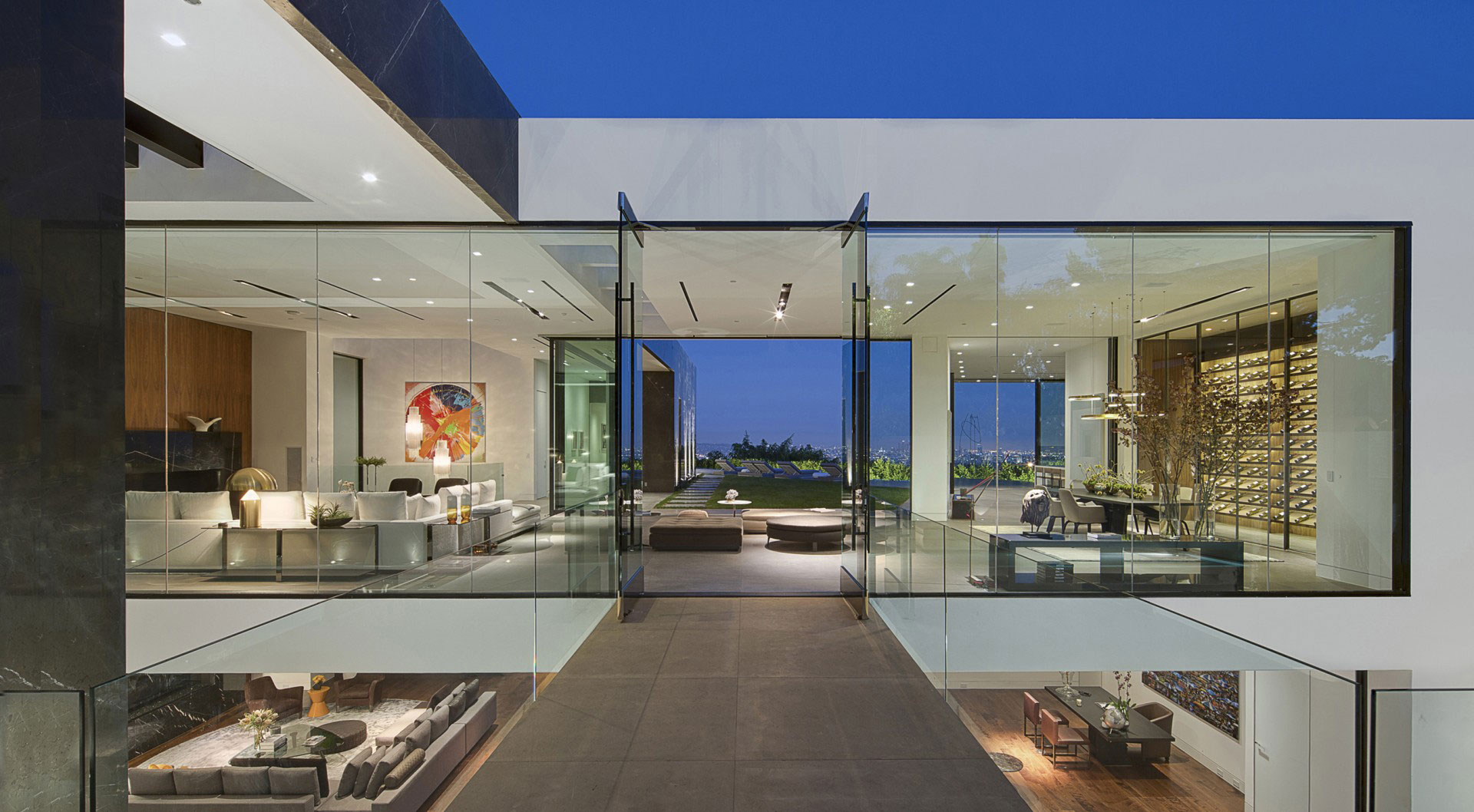 A dramatic glass home overlooking the l a basin for Glass houses for sale in california