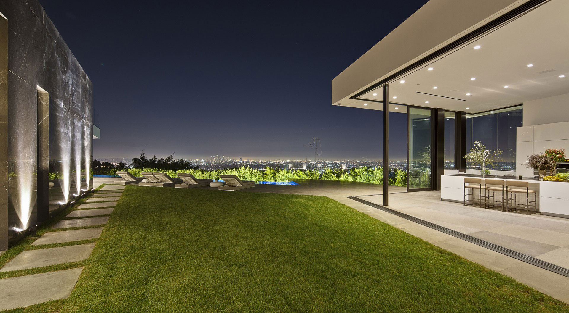 Landscape Ideas - A dramatic glass home overlooking the l a basin