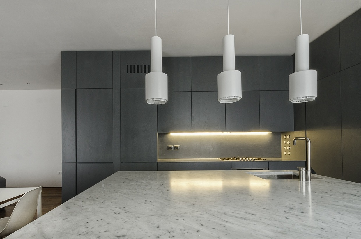 Marble Countertop - Italian apartment renovation brings open space to 1960s home